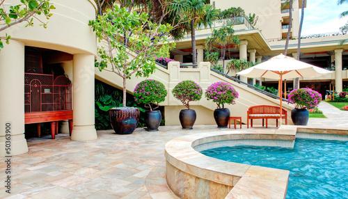 Fototapeta Tropical pool with luxury resort court yard. obraz