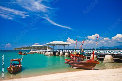 Fototapeta Fishing boat and wood waterfront pavilion. obraz na płótnie