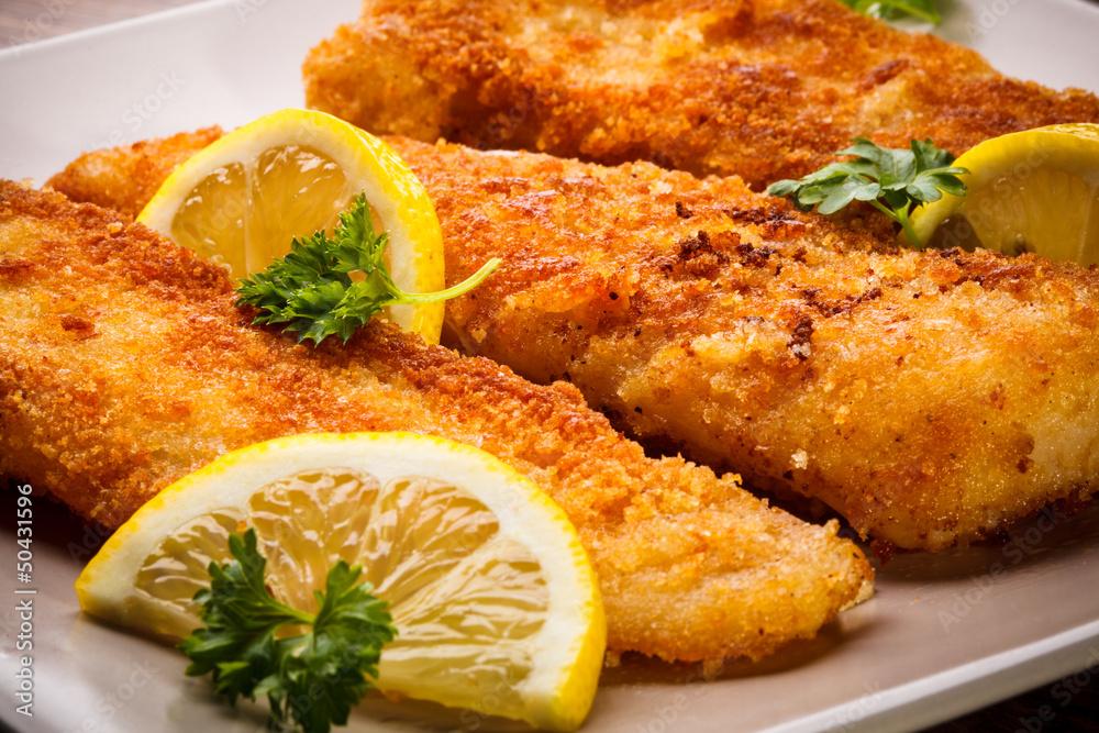 Fototapeta Fish dish - fried fish fillet with vegetables