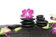 pink orchid with stacked stones on bamboo stick straw mat