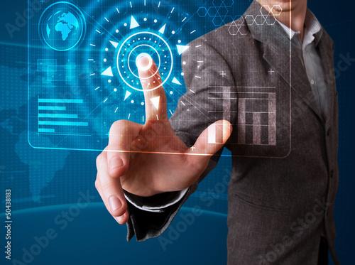 Fotografiet  Businessman pressing high tech type of modern buttons