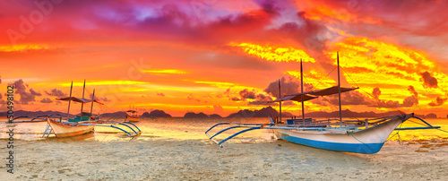 Canvas Prints Orange Glow Boat at sunset