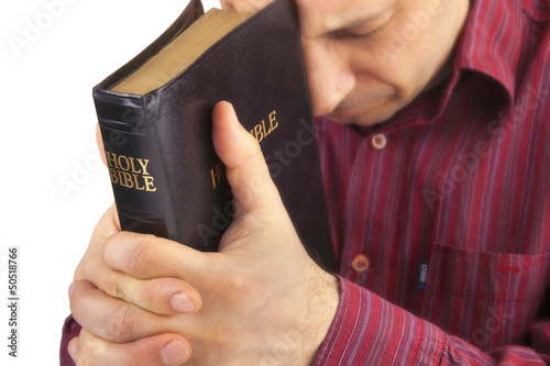 Man Praying Holding the Bible