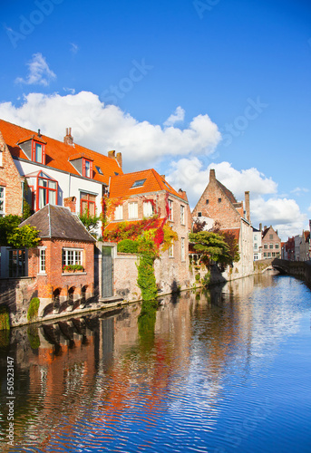 Wall Murals Bridges Beautiful view of a canal and , bridge, red roofs in Bruges, Bel