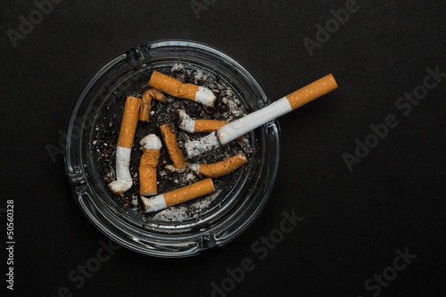 Burning cigarette left in ashtray Canvas Print