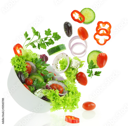 Tuinposter Groenten Fresh mixed vegetables falling into a bowl of salad