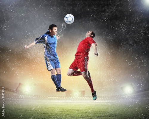 Foto op Plexiglas Voetbal two football players striking the ball