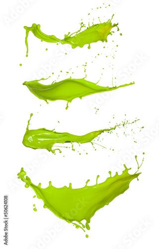 Shot of green paint splashes, isolated on white background Fototapete