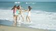 Happy Caucasian Family Walking Outdoors Wet Sand on Beach