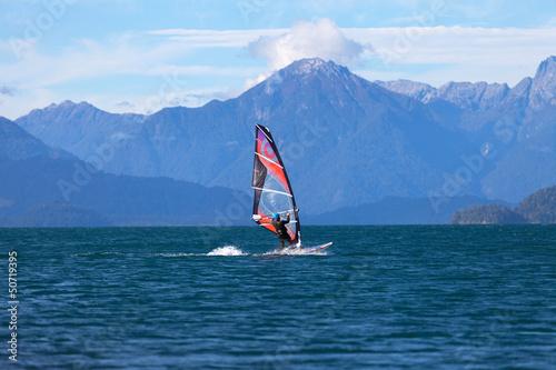 Windsurfer on mountain lake
