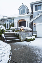 Walkway With Snow Leading To Home