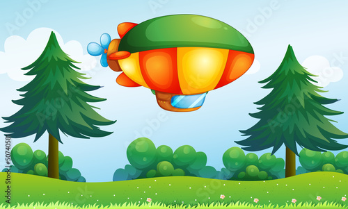 Tuinposter Vliegtuigen, ballon A colorful aircarft above the hill