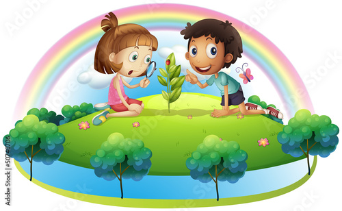 In de dag Regenboog A girl and a boy looking at the plant