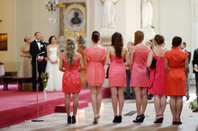 Row Of Bridesmaids In Coral Dr...