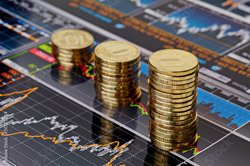 Fototapeta Uptrend stacks coins,on the financial stock charts as backgrou obraz