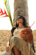 Woman in sarong on a coconut tree