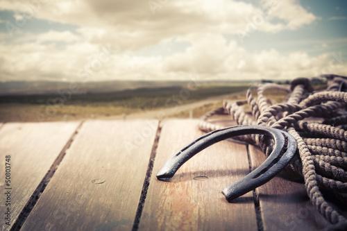 Photo  Iron horseshoe on a vintage background