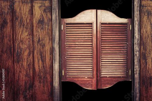 Photo  Old vintage wooden saloon doors