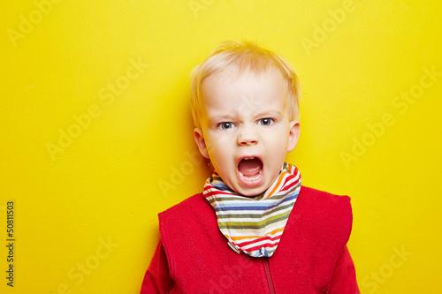 Fotografija  Kleines Kind schreit wütend