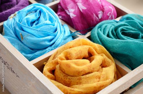 Fotografie, Obraz  Set of colorful scarves in vintage wooden box