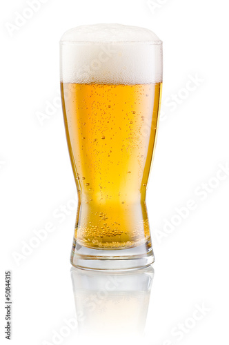Deurstickers Alcohol Glass of fresh beer with cap of foam isolated on white backgroun