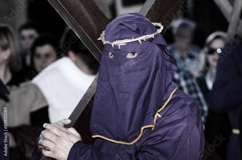 Via Crucis in Lorca, Spain with penitents bearing cross Canvas Print