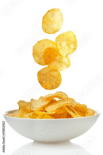 Fotografie, Obraz  Potato chips falling in a bowl