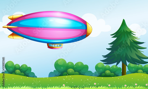 Papiers peints Avion, ballon A pink and blue colored aircraft above the hill