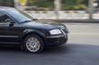 A black car driving.