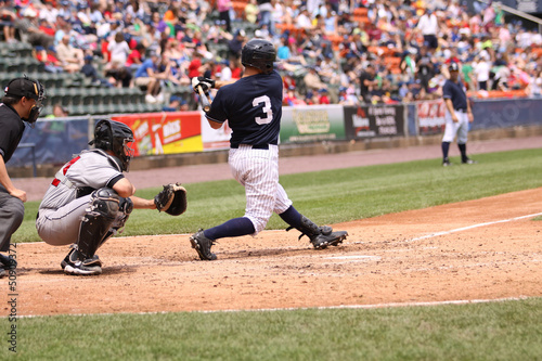 Photo  Baseball batter swinging