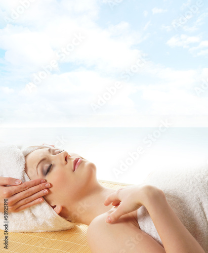 Poster Artist KB Young beautiful lady getting spa treatment isolated on white