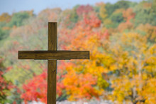 Wooden Cemetery Cross And Fall Color Trees