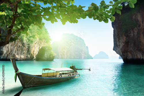 Wall mural - boat on small island in Thailand