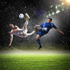 Fototapetatwo football players striking the ball