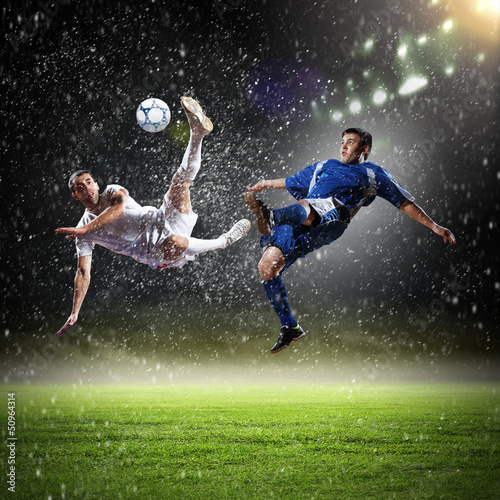 Spoed Foto op Canvas voetbal two football players striking the ball