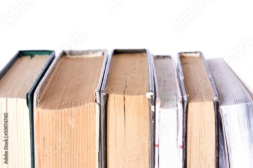 Papiers peints Retro Pile of Old Antique Books on white background