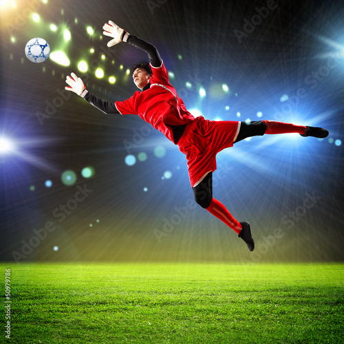 Foto op Plexiglas Voetbal Goalkeeper catches the ball
