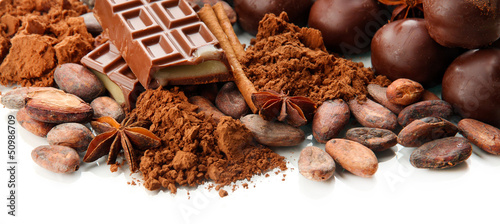 Poster Confiserie Composition of chocolate sweets, cocoa and spices, isolated
