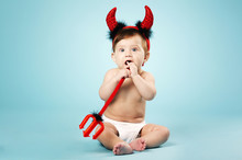 Little Funny Baby With Devil H...