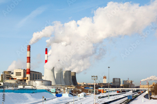 Tuinposter Helicopter Smoking pipes of thermal power plant