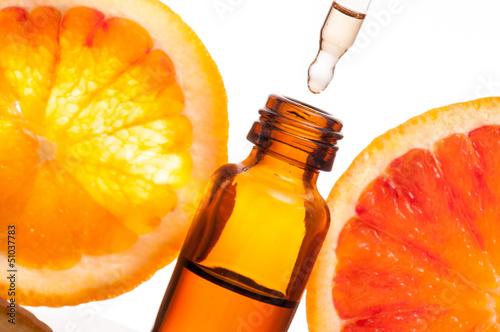 Fotografie, Obraz  Essential oil with orange_Olio essenziale con fetta di arancio