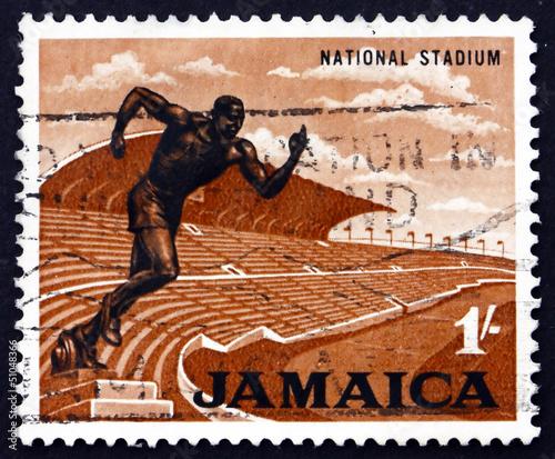 Spoed Foto op Canvas Stadion Postage stamp Jamaica 1964 Stadium and Statue of Runner