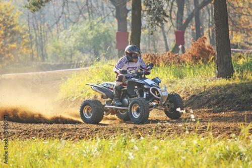 Quad rider in autumn forest