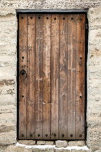 Ancient Wooden Door In Old Sto...