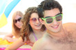 Youth on the beach wearing sunglasses