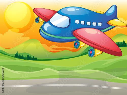 In de dag Vliegtuigen, ballon A blue airplane above the road