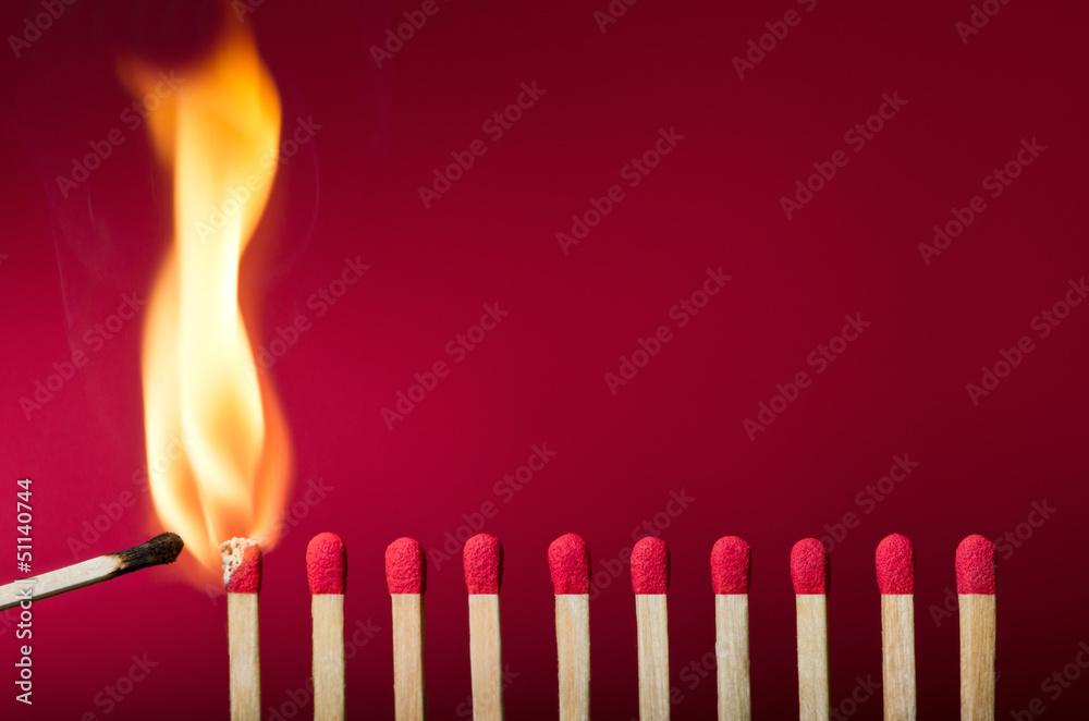 Fototapety, obrazy: Burning match setting fire to its neighbors