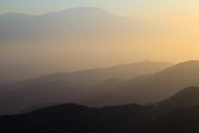 Mountains Of Mojave Desert At Sunset. USA. California.