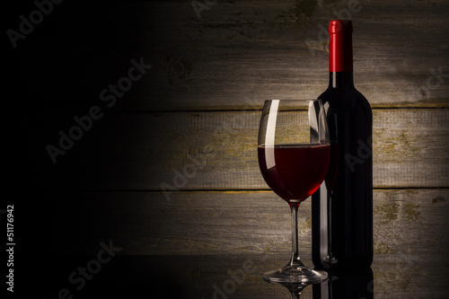 Wine glass and Bottle on a wooden background