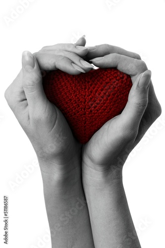 Poster Red, black, white Red heart in cupped hands.